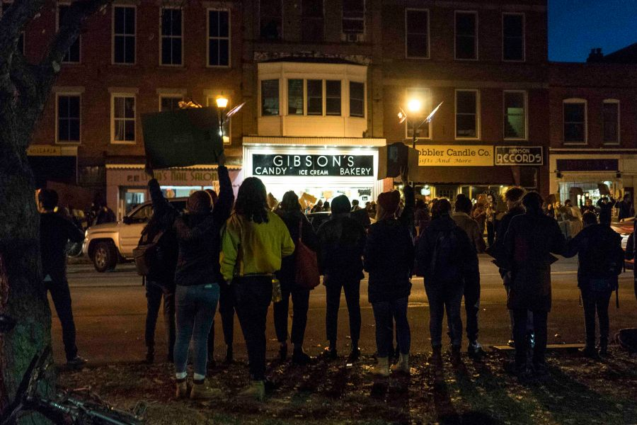 Students+chant+across+the+street+from+Gibson%E2%80%99s+Bakery+in+Tappan+Square+Thursday+evening.+Protests+ran+from+around+11+a.m.+until+Gibson%27s+closed+at+11+p.m.