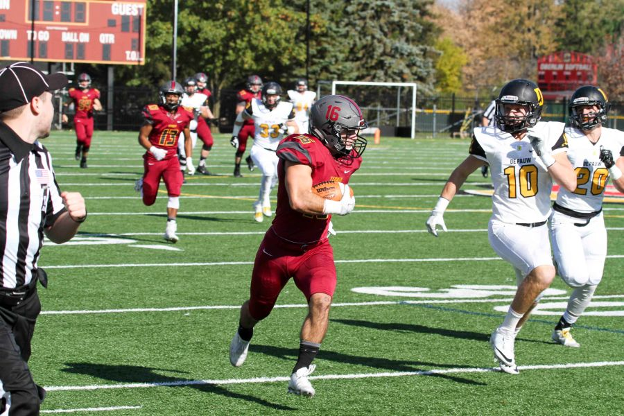 Senior+wide+receiver+Justin+Cruz+sprints+past+DePauw+University+defenders+in+Oberlin%E2%80%99s+50%E2%80%9317+loss+last+Saturday+at+the+Knowlton+Athletic+Complex.+Cruz+ranks+third+in+school+history+with+2%2C156+career+receiving+yards.+