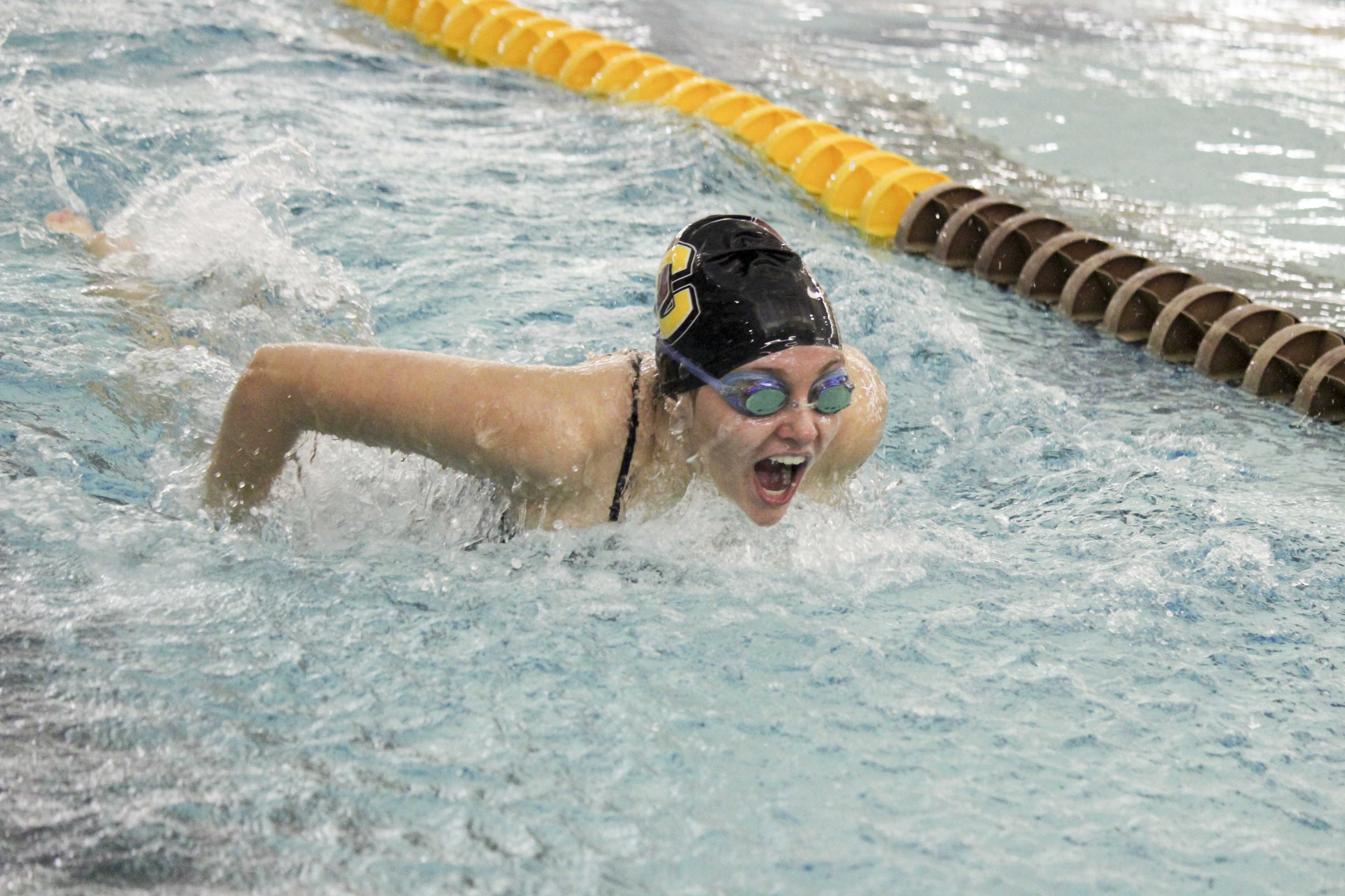 First-year Paige Davies races in the 200-yard butterfly. The swimming and diving teams begin the Fredonia Invitational in Fredonia, NY, today.