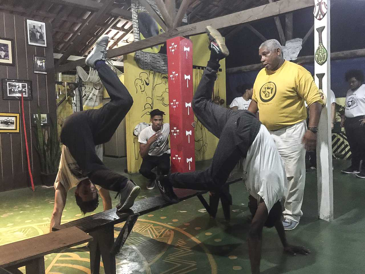 From left to right, College senior Davíd Zager and College junior Deron Essex receive instruction in Capoeira Angola from Mestre Jurandir of the International Capoeira Angola Foundation. Capoeira is a martial art and dance form developed by Angolans in Brazil in the 16th century. The art form is practiced in countries all over the world, and made its way to the U.S. in the late 20th century.  Several students took part in the trip to Brazil over Winter Term, led by Associate Professor of Theater and Africana Studies Justin Emeka, OC '95. Students spent 20 days in the cities of Belo Horizonte and Salvador, working with three different Capoeira groups and participating in a facilitated discussion on how the art can be used to face racial divides and inequality in the U.S.