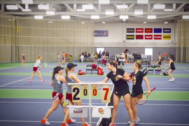 First-years+Lena+Rich+and+Rainie+Heck+shake+hands+just+after+match+point.+The+duo+won+an+exhibition+doubles+match+at+No.+4+8%E2%80%932+against+Indiana+University+of+Pennsylvania.+The+Crimson+Hawks+defeated+the+Yeowomen+7%E2%80%932+in+the%0Asecond+match+of+a+home-opener+double+header+last+Saturday.
