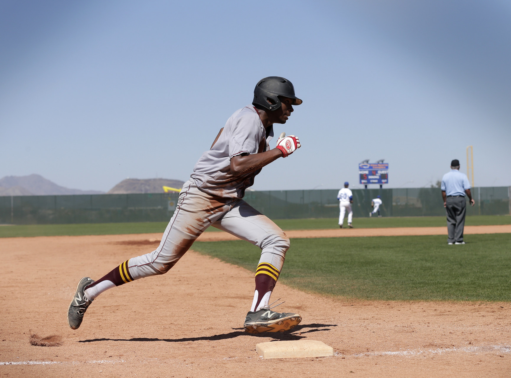 First-year outfielder Amari Newman rounds the base during a game against the Luther College Norse on March 19 on the team's spring break trip in Tucson, AZ. The team will head to Granville, Ohio, tomorrow to play the Denison University Big Red.