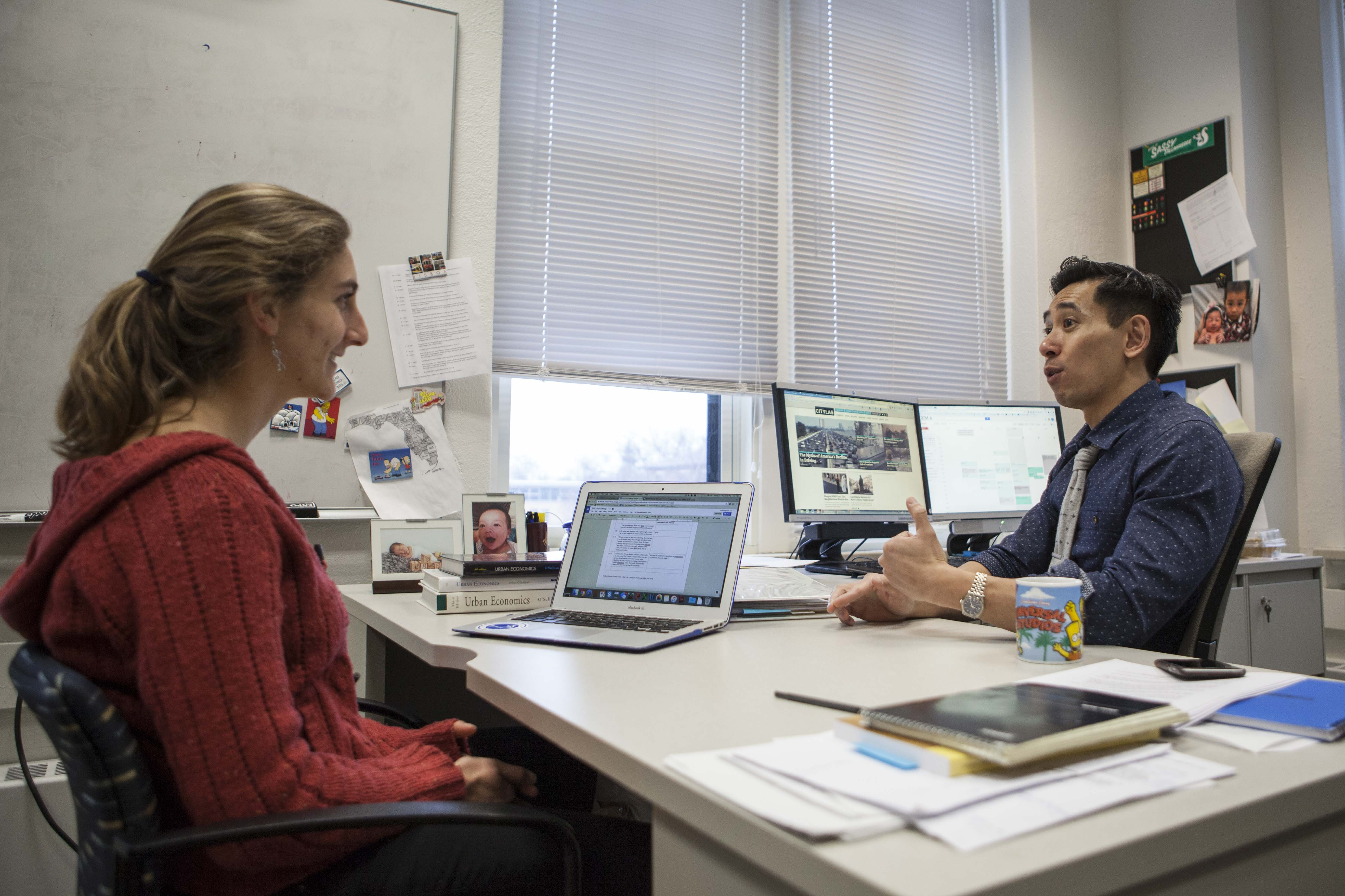 College junior Naomi Roswell and Associate Professor of Economics Ron Cheung meet in Cheung's office in Rice Hall. They are partners in the Student-Faculty Partnership Program, which engages faculty and students in a collaborative effort to improve teaching quality.