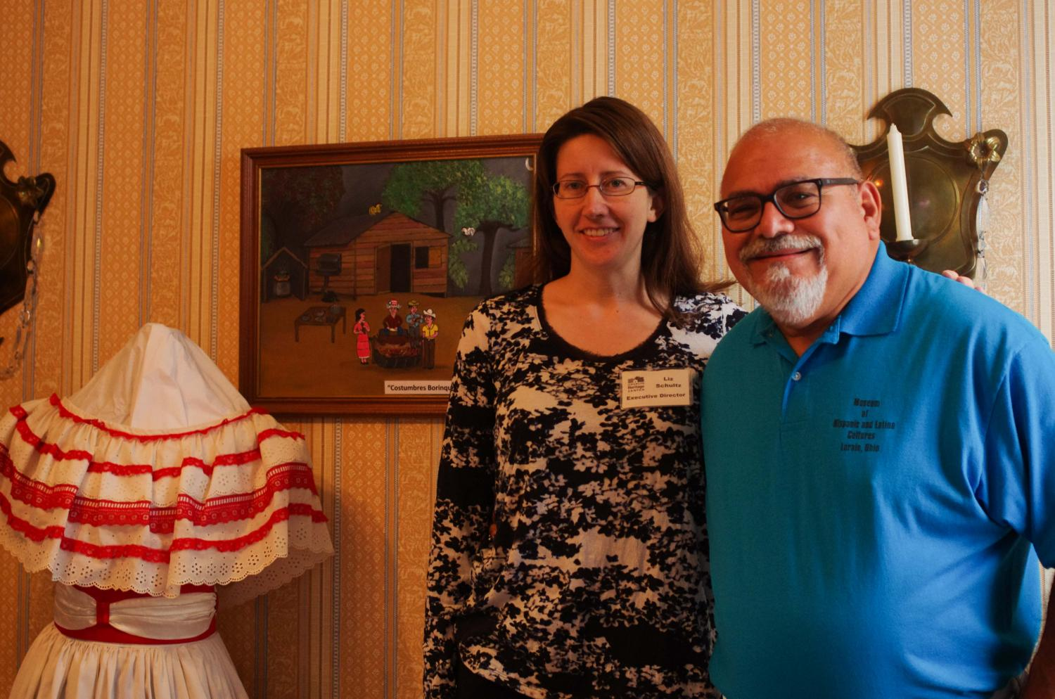 Liz Schultz (left), executive director of the Oberlin Heritage Center, and Guillermo Arriaga, president and director of the Museum of Hispanic and Latino Cultures of Lorain, have collaboratively curated an exhibition on Hispanic and Latino culture. that will be open to the public in Monroe House through September.