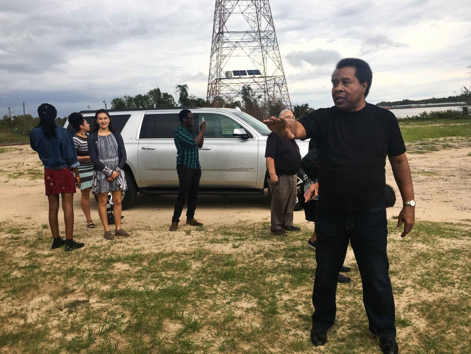 Major Joe Womack of the Mobile Environmental Justice Action Coalition leads Oberlin students on a tour of Africatown.