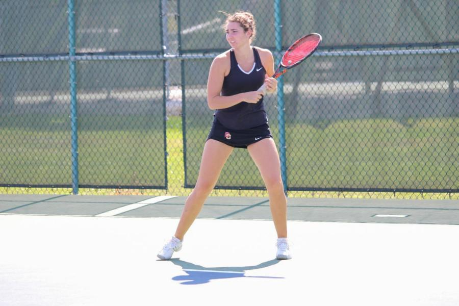 Sophomore+Lena+Rich+prepares+to+return+a+serve+at+the+Intercollegiate+Tennis+Association+Central+Regionals+in+September.+Rich+and+her+doubles+partner%2C+senior+Mayada+Audeh%2C+had+a+decisive+8%E2%80%934+win+Saturday+against+Kalamazoo+College.