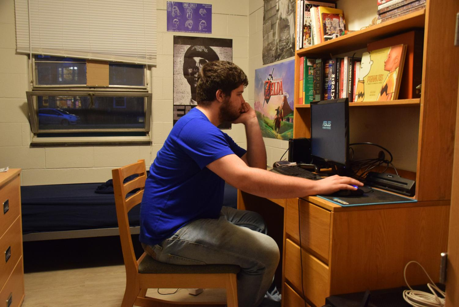 College sophomore James Dryden sits in his Langston Hall dorm room. Langston and other dorms experienced a string of thefts in recent weeks.