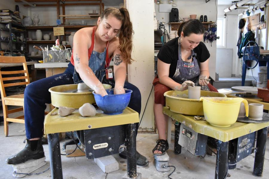 Members+of+the+Pottery+Co-Op+sit+at+potters+wheels.+The+co-op+aims+to+be+an+inclusive+space+for+students+of+all+levels+who+want+to%0Alearn+how+to+create+pottery.+