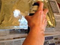 spraying shaving cream on cookie sheet