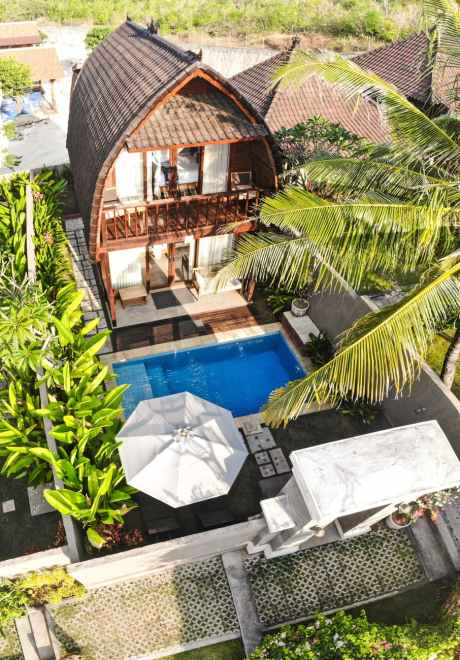 brown wooden house with pool