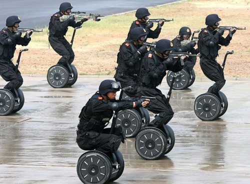 Members of China's armed police unit practice using the 'Anti-Terror Assault Vehicle' during an anti-terror drill in Jinan - Getty