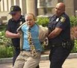(We love this obviously faked photo of Karl Rove being arrested.)