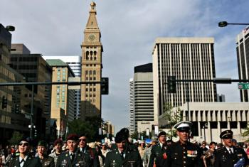 Members of Iraq Veterans Against The War (IVAW) march in downtown Denver, leading several thousands activists towards The Pepsi Center. While some feared police would attempt to stop the march, officers surprised the group by escorting the protesters through city streets, redirecting traffic and pedestrians along the way. (Photo: Rocky Mountain News)