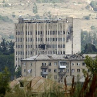 A government building in Tskhinvali, the captial of South Ossetia, damaged by Georgian shelling. Russia says Georgia committed war crimes by attacking (David Mdzinarishvili/Reuters)