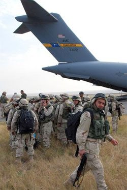 U.S. military planes transported Georgian troops from Iraq to deploy against Russians