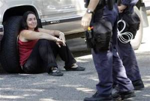 Woman arrested after police raided house of protest organizers.