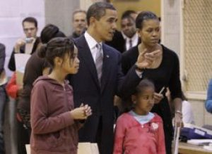 Sen. Barack Obama with Michelle and daughters as he votes on November 4.