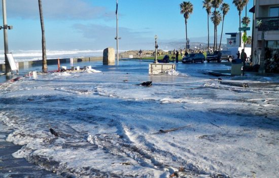 Tables and other debris from the surf contest slid into OB streets.