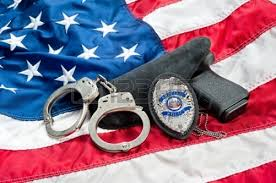 cop gun badge cuffs flag