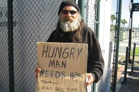 homeless w sign