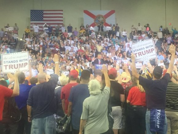 Trump supporters salute 2 3-5-16