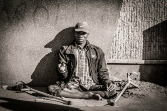 Photograph of handicapped man begging in the streets