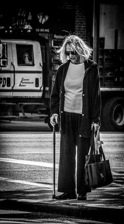 Portrait series of elderly lady with youngish hairstyle in street - part 2