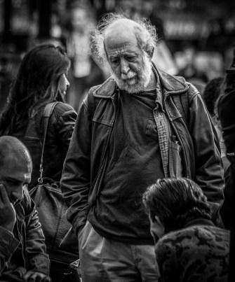 Monochrome portrait of elderly man with white hair
