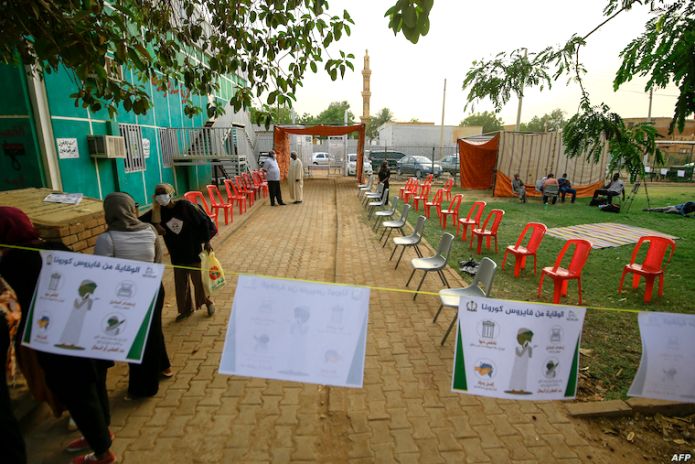 Doctors, nurses, and volunteers set up a treatment center in the Shambat district of Khartoum