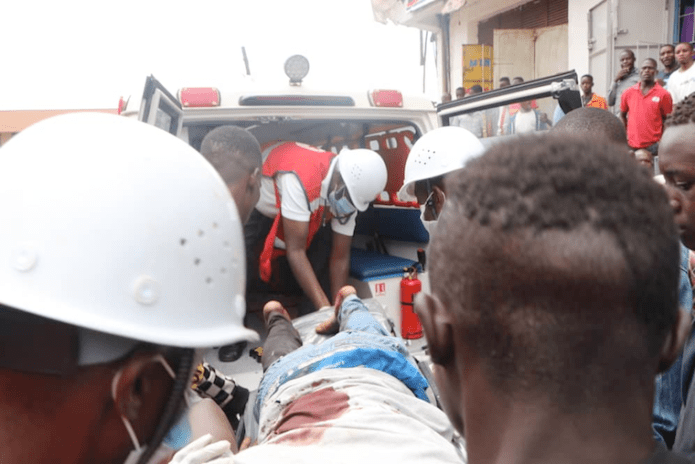Uganda Red Cross Society personnel rescue one of the injured victims