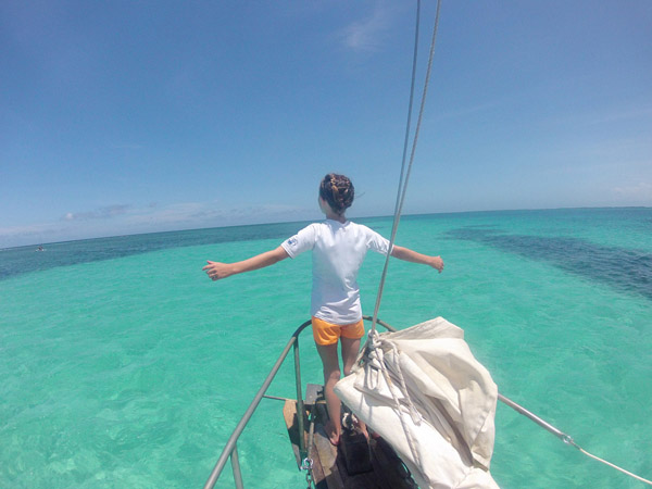 Cozette as the king of the world, during our cruise with Ragamuffin Tours. #Belize