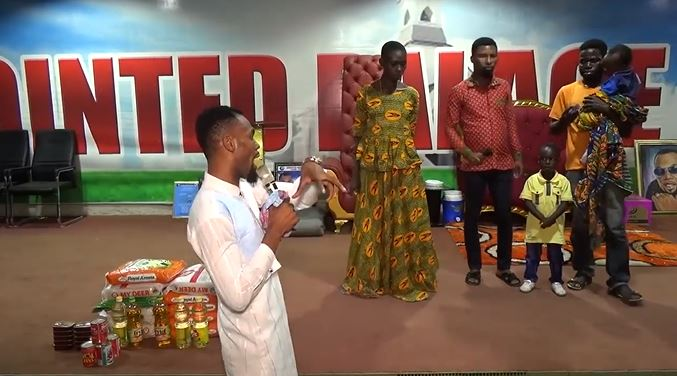 Rev. Obofour shows 'rare love' to woman with 'strange swollen legs' [Video]