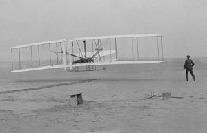 The Wright Brothers' first flight on December 17, 1903 in Kill Devil Hills, North Carolina, photographed by John T. Daniels.