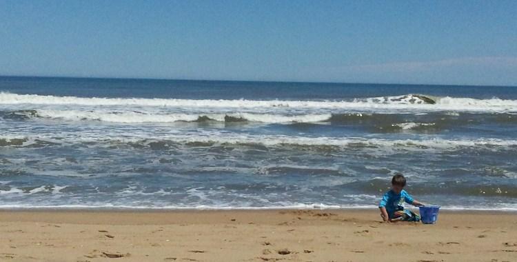 Ozzie Artz enjoys a day on the beach in Nags Head, NC.