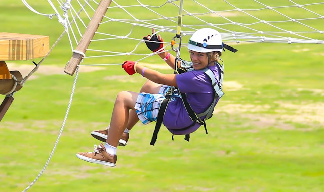 OBX Entertainment thrill seeker Jasper Dean took on the arial obstacle course at First Flight Adventure Park in Nags Head, NC on August 10, 2014. (photo by OBXentertainment.com)