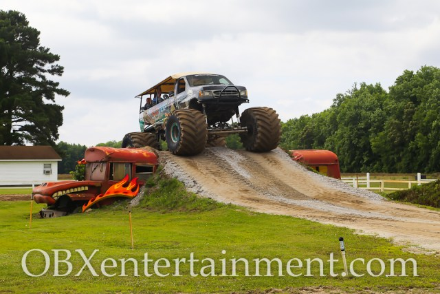 'OBXE TV' host Sue Artz takes a monster truck ride with Son-uva Digger driver Ryan Anderson at Grave Digger's Dungeon, Currituck, NC on June 6, 2015 (photo by Matt Artz for OBXentertainment.com)