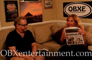 Sue Artz with Outer Banks Sentinel owner Mark Jurkowitz on the set of the OBX Entertainment original series 'OBXE TV' on July 29, 2015.