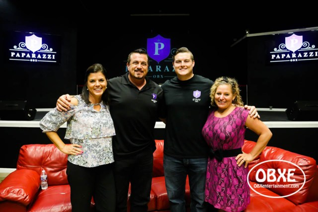 Paparazzi OBX owners Julie Beatty, Michael Beatty Sr., and Mike Beatty Jr. with 'OBXE TV' host Sue Artz, photographed on August 1, 2018 by Matt Artz for OBX Entertainment.
