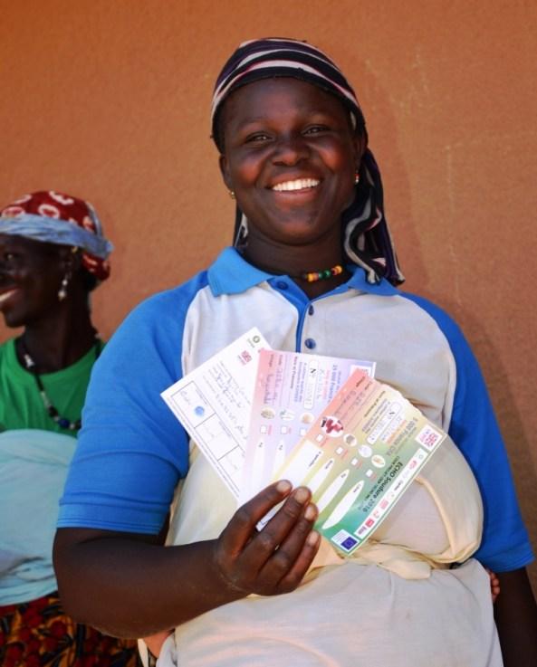 •Cette bénéficiaire du village de Borguiendé retrouve le sourire à la réception des coupons