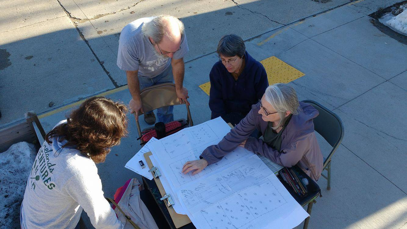 The OM Grow team plotting out this year's raised bed gardens!