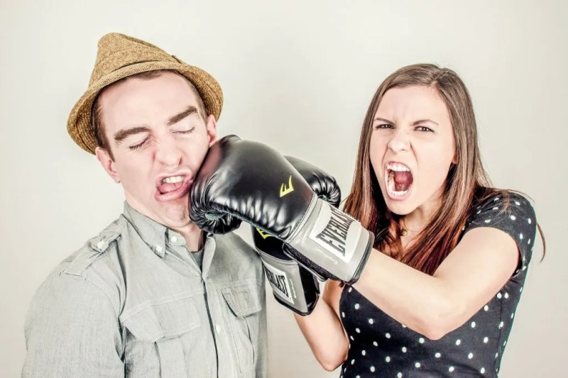 Photo of Woman Punching Man in Face