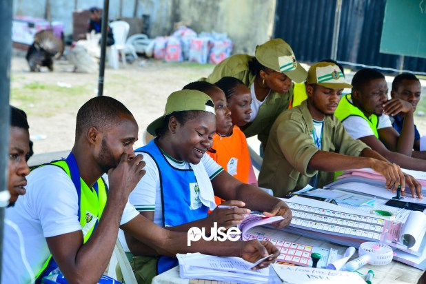 Members of the NYSC as INEC ad-hoc staff at a polling unit in Victoria Island (Pulse)