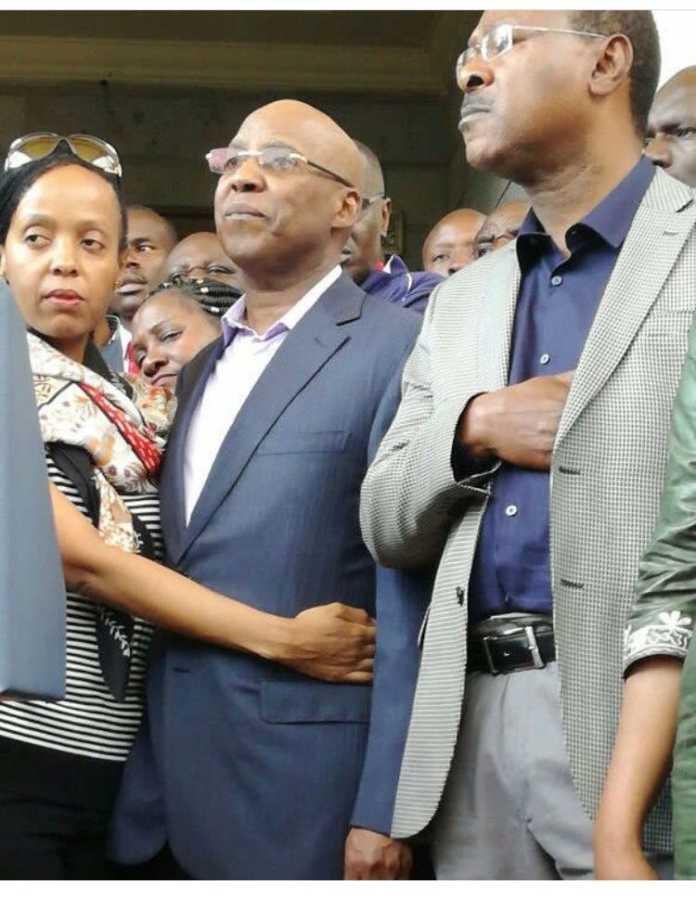 Jimmy Wanjigi held by his wife Irene Nzisa beside Bungoma Senator Moses Wetangula during a past presser (Twitter)