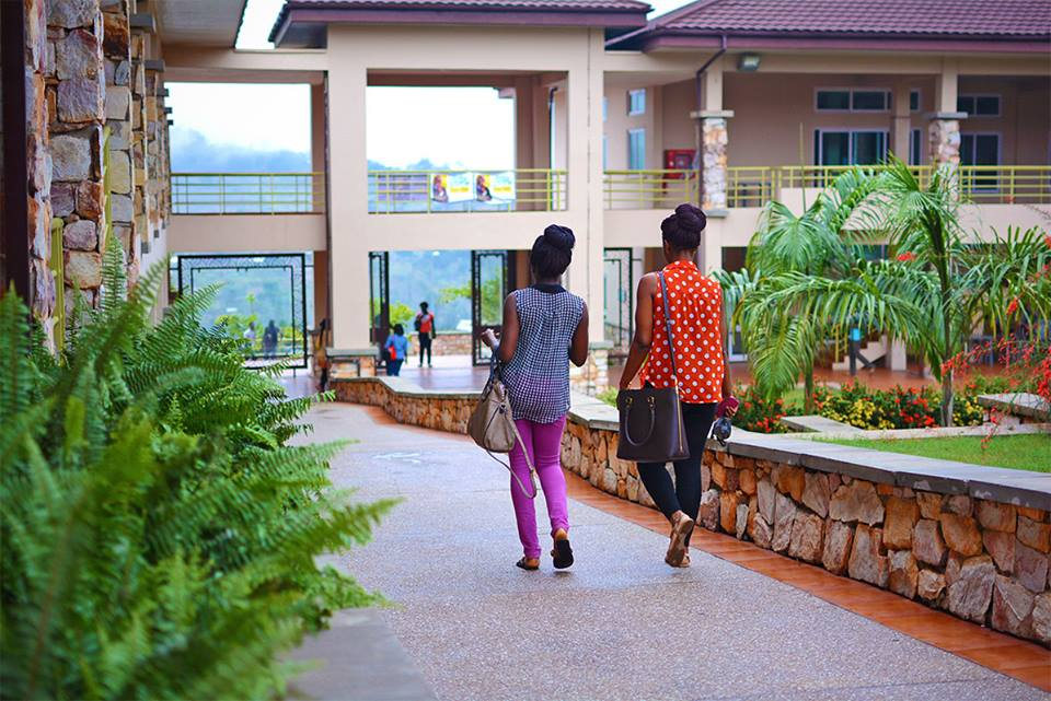 Students walk past the Cornfield and Archer Courtyard at Ashesi University