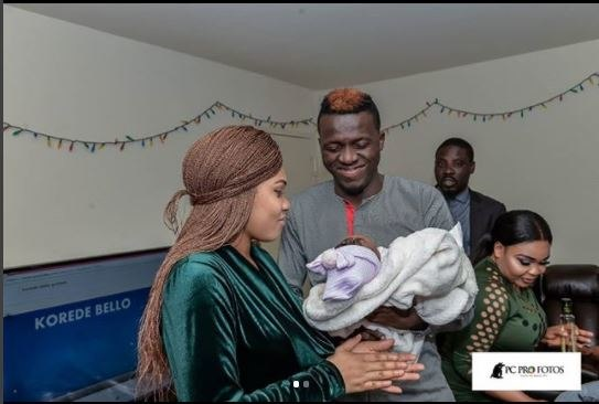 Akpororo and wife all smiles with one of the twins