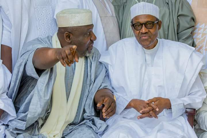 Rochas Okorocha (left) and President Muhammadu Buhari [The Sun Nigeria]