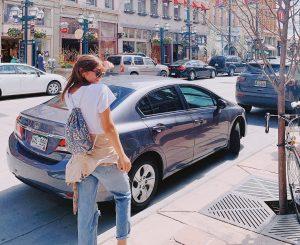 A girl in Larimer Square in Denver with her OCDrawstring bag.