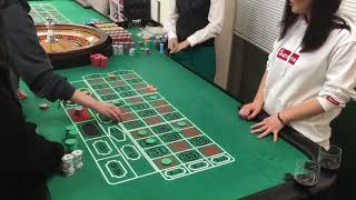 casino roulette dealer demonstration with students.