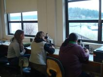 Dr. Evelyn Lessard looking at plankton with Amy and Kiely