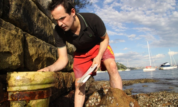 Ecologist Mark Browne takes samples from the shoreline. His pioneering work on microfiber waste has received little support from clothing brands. Photo: Mark Browne